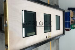assembling-security-door-with-brass-threshold
